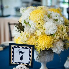 I like the pop of the yellow centerpiece with the navy tablecloth