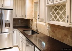 Cream cabinets with back splashes | brown countertop cream cabinet travertine subway backsplash tile