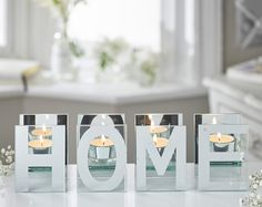 Home Tealight Holder.   Separate lettered mirrored tea lights holder looks fantastic even when not in use each letter is H10 x W7.5 x D6.5cm. Tea lights not included.
