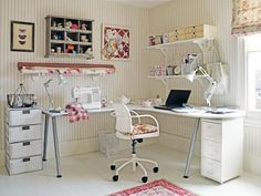 Craft room decorated with striped wallpaper pattern, painted white storage baskets, contemporary office furniture in white color and pink accents