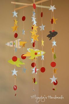 Rocket Mobile Chandelier - My head is spinning with all of the theme possibilities!  The Silhouette would make a project like this super easy.