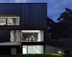 Seaside House with Concrete and Timber Cladding by Ultra Architects