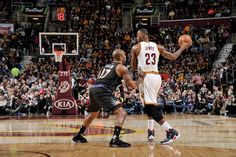 LeBron James #23 of the Cleveland Cavaliers handles the ball against P.J. Tucker #17 of the Phoenix Suns on January 27, 2016 at Quicken Loans Arena in Cleveland, Ohio.