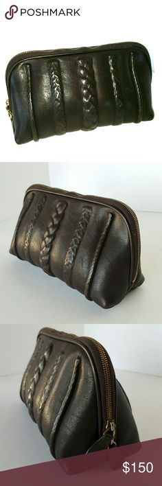 Bottega Veneta Make-up Case Pouch Braided genuine chocolate brown leather design Bottega Veneta. 110% Authentic. Gold-tone hardware in a rusyic gold,  RiRi italian zippers, double zippers. Blue cotton fabric lining, pre-owned and does shows signs of loose eyeshadow powder. I will clean it thoroughly again before shipping.  All in all the case is in great condition! Authenticity is still readable, up clise. The brown leather label is marked Bottega Veneta- Made In Italy. Fast ship! Bottega…