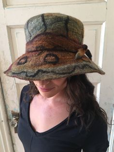 A personal favorite from my Etsy shop https://www.etsy.com/listing/559680385/felted-hat-felt-hat-hand-felted-hat-wool