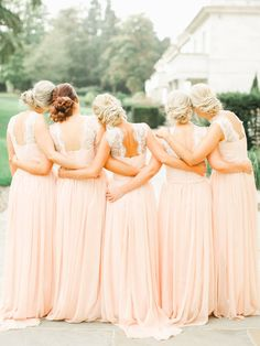 Love the long blush bridesmaid gowns with lace backing | Romantic blush wedding at Rudding Park in Harrogate via @rockmywedding