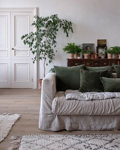 natural linen sofa with green velvet cushions Interior Decorating Styles, Interior Design, Old Fireplace, Unique Furniture, Furniture Usa, Luxury Furniture, Furniture Movers, Plywood Furniture, Cheap Furniture