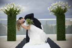 Green and white wedding. Modern ceremony stands. Grass stands. Unusual and unique!