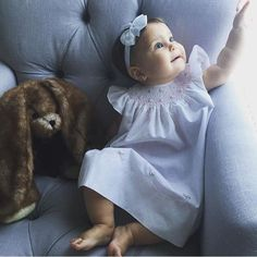 How sweet is this little doll playing with the curtains in her Sunday best! Our Fly Sleeve Bishop dress with pearls is so dainty and beautiful it's always a favorite by all! Available in white, pink, & blue in sizes 3m-24m! http://feltmanbrothers.com/fly-sleeve-bishop-dress-with-pearls/