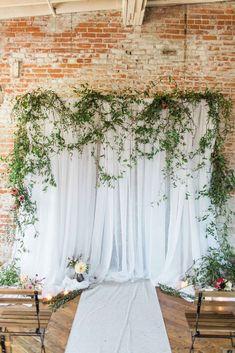 White draped wedding ceremony backdrop with greenery - Arielle Peters Workshop Style Shoot | WeddingDay Magazine