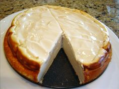"""""""Impossible"""" Cheesecake: Mix everything together and it forms a magical """"crust"""" on the bottom while it bakes :)"""
