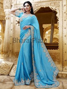 Spectacular sky blue color satin #Chiffon saree with glittering diamantes, kundan and cutdana work. Item Code : SKD6017 http://www.bharatplaza.com/new-arrivals/sarees.html