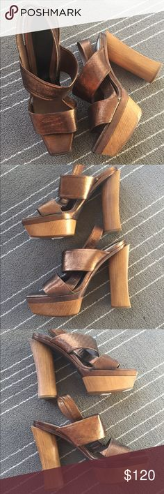 MARNI Bronze Slingback Platform Wood Heels Sandals 100% Authentic. Absolutely Gorgeous! Marni bronze slingback 5 inch platform wood heels. In Excellent Condition. A few blemishes on the sides (please see pictures). Bottom soles doesn't show signs of wear. Originally bought at Neiman Marcus (tag still on). No box. No dust bag. No trades. Marni Shoes Heels