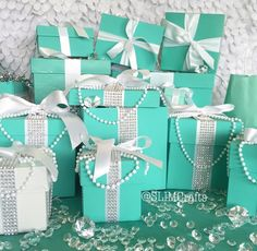 Want a bit more glam? Try these handmade 9x9x9 bling gift boxes with ribbon. Featuring pearls and bling ribbon, these beauties may steal the spotlight. Leave them closed or fill them up with more blin
