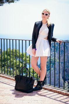 Love the cutout dress, with the heavy jacket <3