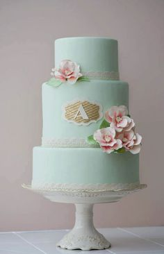 Teal Tiered Cake with Gold Monogram A and Pink Flowers. Color palette to die for!