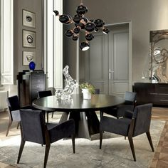 Designed by Selva and crafted by expert artisans, this bold yet refined chair will add a touch of urban chic to any decor with its streamlined silhouette and. Large Round Dining Table, Dining Room Table, Dining Area, Kitchen Tables, Kitchen Dining, Apartment Living, Living Room, Flat Ideas, Apartment Interior Design