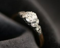 PRETTY. Subtle and not having a huge stone, and a lovely setting. This is my kind of ring!!!!