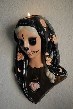 In the Garden of the Dead, Candle Sconce, Dead Mary