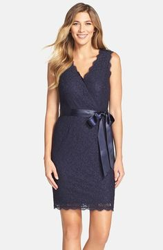 Women's Adrianna Papell Lace Faux Wrap Dress.  A ribbon belt accentuates the elegant surplice neckline of a romantic cocktail dress featuring scalloped trim and a dainty lace overlay. black, french coral, mulberry, navy, radish.