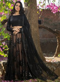 Black and Nude Sequins Embroidered Lehenga features a dhupioni silk blouse with sequins embroidery all over, nude lehenga with black net overlay and sequins embellishments all over alongside a sequins embroidered net dupatta. Blouse Lehenga, Lehnga Dress, Bridal Lehenga Choli, Red Lehenga, Ghagra Choli, Silk Dupatta, Sharara, Saree, Indian Fashion Dresses