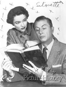 jane wyatt looks over robert youngs shoulder while he is reading a book in a publicity photograph for the television show father knows best - Father Knows Best Home For Christmas 1977