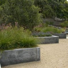 Can't imagine we'll blow budget on garden boxes, but love the contrast of materials here
