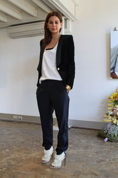 Vogue Australia's Christine Centenera wearing Balmain blazer, Josh Goot pants and Kanye West shoes. Kim, you did it all wrong