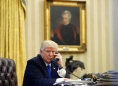 Donald Trump FILE – In this Saturday, Jan. 28, 2017 file photo, President Donald Trump speaks on the telephone with Australian Prime Minister Malcolm Turnbull in the Oval Office of the White House in Washington. In the background is a portrait of former President Andrew Jackson which Trump had installed in the first few days of his administration.(AP Photo/Alex Brandon, File)