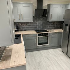 How gorgeous is this grey kitchen on grey tiles colour combo? We your kitchen s… Grey Kitchen Cupboards, Grey Kitchen Tiles, Sage Kitchen, Grey Kitchen Designs, Kitchen Room Design, Contemporary Kitchen Design, Kitchen Cabinet Design, Home Decor Kitchen, Kitchen Interior