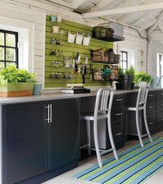 Painted slatwall for kitchen storage.  Great for a pantry with minimum space on one side