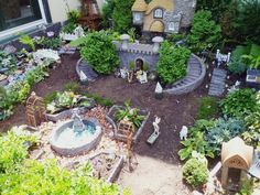 fairy garden theme with mini castle feature absolutely fabulous and wonderful idea