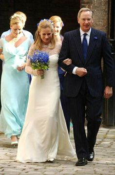 Lady Davina Windsor is accompanied by her father The Duke of  Gloucester to the Chapel at Kensington Palace for her marriage to Mr.  Gary Lewis in July 2004