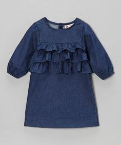 Lovely ruffles and sweet chambray make this classic piece even more fun to wear. Pretty puff sleeves and a relaxed fit are comfy and cute.