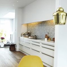 Tiling and streamlined cupboard sufaces  Kitchen   Take a tour around an elegant modern home   housetohome.co.uk
