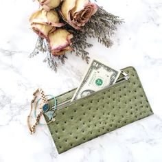 "Faux Leather Wallet in Green Faux Leather Wallet in Green Simple thin wallet with a zipper. Size: 8.5"" x 4.5"" Never Used.   ✗No paypal, No trade ✗I don't sell on any other site ✔I do accept reasonable offers ✔️Items will be shipped within 1-2 business days Bundle 2+ items to get 10% off! Bags Wallets"