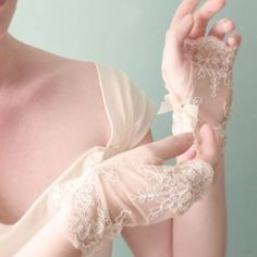 Delicate vintage style lace wedding gloves