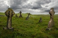 Gravestones from the 1600's in the middle of a meadow in rural Scotland.