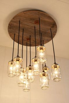 Mason Jar Chandelier - Mason Jar lighting - Upcycled Wood I bet I could make this