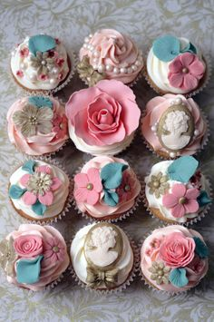 cupcakes decorated with sugar flowers by Olofson Design