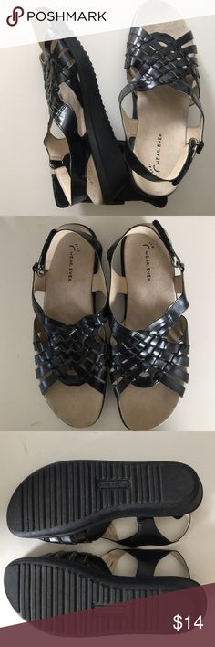"Black ""wear.ever."" Sandals. Like new condition. Worn once indoors. Not foot marks. Man made materials. 7-1/2 M. Velcro adjustable straps. Wedge about 1-1/2 inch on heel.  Wear ever Shoes Sandals"