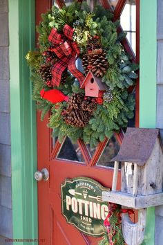 Potting Shed decorated for Christmas with wreath with pine cones, plaid, birdhouse, and cardinal | homeiswheretheboatis.net #LynchCreekFarm #Christmas #sheshed #pottingshed #greenery
