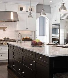 """When hanging multiple pendants over a bar or counter top, remember what is commonly known as """"The Rule of Three."""" It calls for the use of three identical fixtures to establish a rhythm and sense of balance, patterns of odd numbered elements being more pleasing to the human eye."""