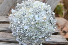 Classic heirloom pearl brooch bouquet deposit on a by Noaki