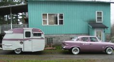 Cute purple and white vintage car and camper