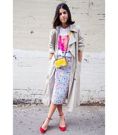 Leandra Medine of The Man Repeller Mina + Olya trench coat; C.O.I. t-shirt; Jil Sander skirt; Valentino heels.