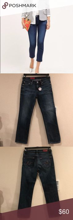 """New AG Jeans """"The Capri"""" Medium Wash Cropped Jeans NWOT """"The Capri"""" Straight Slim Cropped Jeans.  They have a darker medium wash. 2% elastane 98% Cotton. Stitching is pink. Measurements Laying Flat (Inseam 23"""". Waist 12"""", Rise 7"""") Ag Adriano Goldschmied Jeans Ankle & Cropped"""