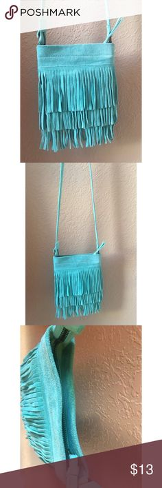 Turquoise suede fringe crossbody bag This little bag is so cute! Turquoise color & fringe galore😍 Bags Crossbody Bags
