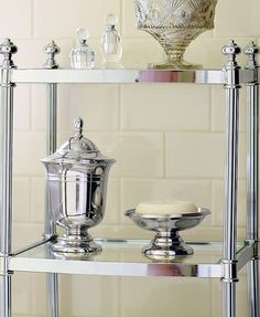 Elegantly display your bath essentials  atop the sophisticated beveled shelves of the Belmont 3-Tier Etagere.