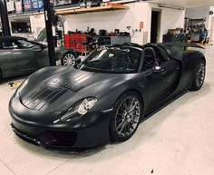 Porsche 918 Spider wrapped in Satin Black w/ a Black Martini livery sticker and a set of HRE P103 wheels painted in finished brushed titanium Photo taken by: @hre_wheels/@imolamotorsports on Instagram